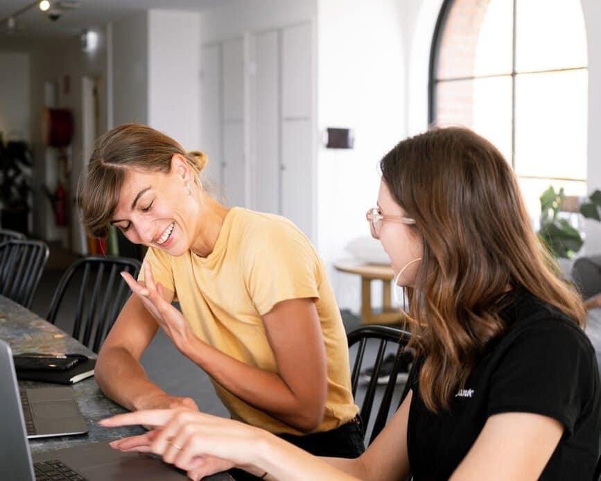 photo of women having conversation